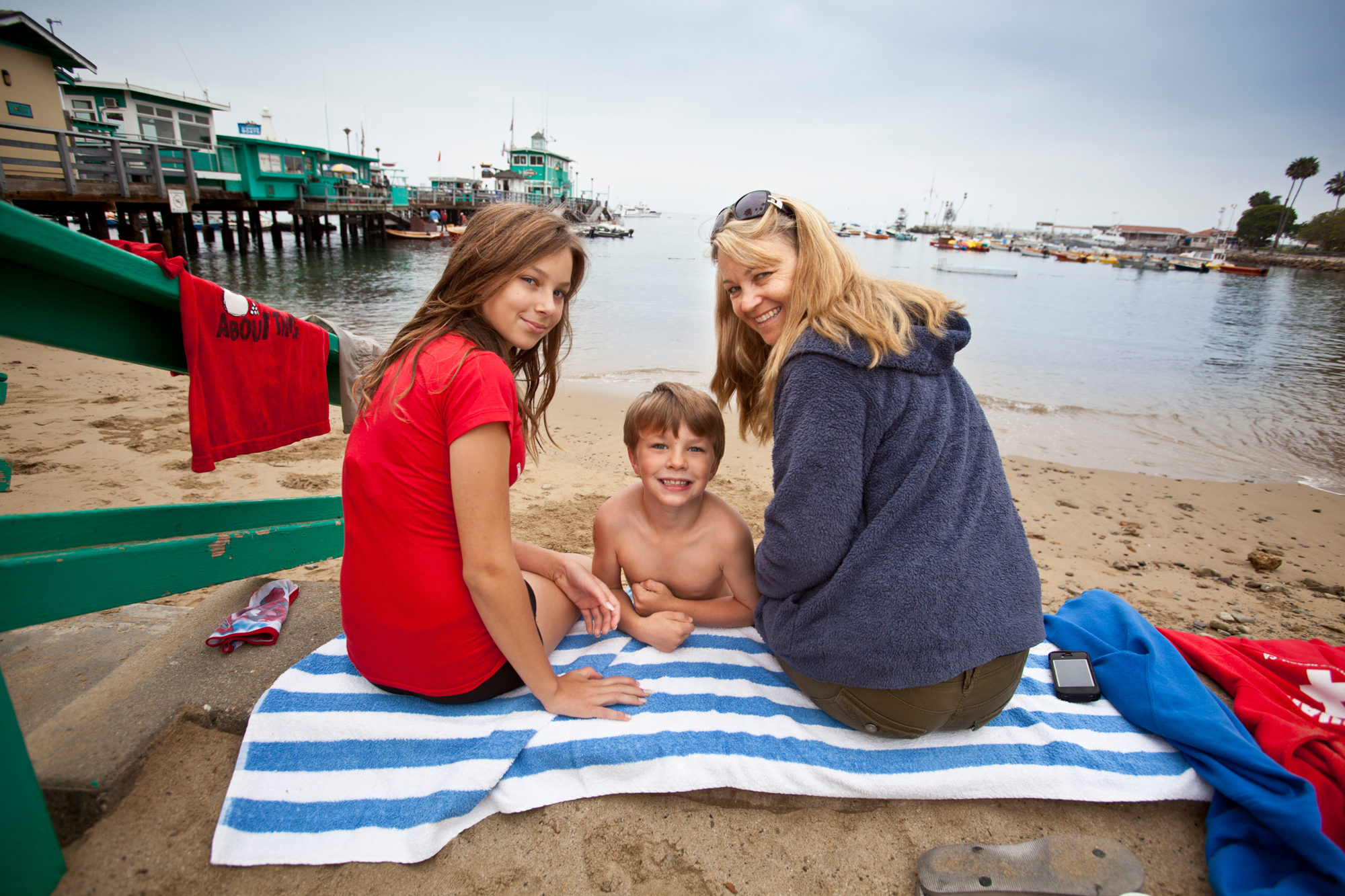 Two women and a young boy enjoying time at Avalon's beach