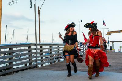 women dressed up as pirates on the dock in two harbors