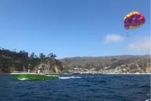 Guests enjoying a sunny day high in the sky parasailing