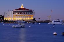 The Catalina Casino decorated for the holidays at dusk.