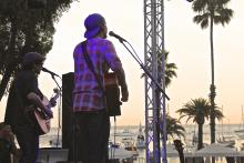 signer rocking the stage with a beautiful catalina island sunset